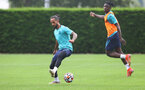 SOUTHAMPTON, ENGLAND - JULY 08: Theo Walcott(L) and Mohammed Salisu during a Southampton FC pre season training session at the Staplewood Campus on July 08, 2021 in Southampton, England. (Photo by Matt Watson/Southampton FC via Getty Images)