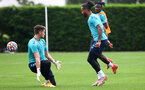 SOUTHAMPTON, ENGLAND - JULY 08: Theo Walcott(R) beats keeper Harry Lewis during a Southampton FC pre season training session at the Staplewood Campus on July 08, 2021 in Southampton, England. (Photo by Matt Watson/Southampton FC via Getty Images)