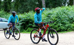 SOUTHAMPTON, ENGLAND - JULY 15: Michael Obafemi(L) and Moussa Djenepo(R) during team building cycle ride around Deerleap, New Forest on July 15, 2021 in Southampton, England. (Photo by Isabelle Field/Southampton FC via Getty Images)