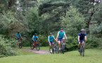 SOUTHAMPTON, ENGLAND - JULY 15: Theo Walcott(L), Fraser Forster, and Alex McCarthy(R) during team building cycle ride around Deerleap, New Forest on July 15, 2021 in Southampton, England. (Photo by Isabelle Field/Southampton FC via Getty Images)