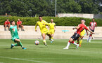 SOUTHAMPTON, ENGLAND - JULY 24: Shane Long(R) of Southampton opens the scoring during a pre-season friendly match between Southampton FC and Fulham at The Staplewood Campus on July 24, 2021 in Southampton, England. Photo by Matt Watson/Southampton FC via Getty Images