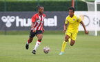 SOUTHAMPTON, ENGLAND - JULY 24: Theo Walcott(L) of Southampton during a pre-season friendly match between Southampton FC and Fulham at The Staplewood Campus on July 24, 2021 in Southampton, England. Photo by Matt Watson/Southampton FC via Getty Images