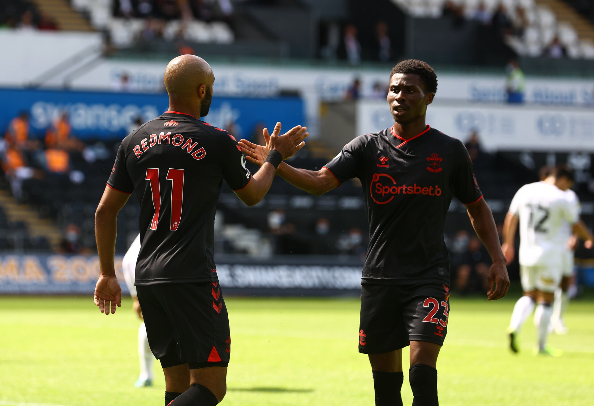 SWANSEA, WALES - JULY 31: Nathan Redmond(L) and Nathan Tella of Southampton during the pre-season friendly match between Swansea City and Southampton FC, at The Liberty Stadium on July 31, 2021 in Swansea, Wales. (Photo by Matt Watson/Southampton FC via Getty Images)