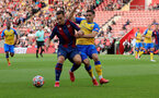 SOUTHAMPTON, ENGLAND - AUGUST 04: Pablo Martinez(L) of Levante and Romian Perraud(R) of Southampton during pre-season friendly between Southampton and Levante at St Mary's Stadium on August 04, 2021 in Southampton, England. (Photo by Isabelle Field/Southampton FC via Getty Images)