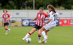 SOUTHAMPTON, ENGLAND - AUGUST 15: Georgie Freeland(L) of Southampton during the FA Women's National League Southern Premier match between Southampton Women's and MK Dons Ladies at Snow's Stadium on August 15, 2021 in Southampton, England. (Photo by Isabelle Field/Southampton FC via Getty Images)