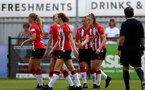 SOUTHAMPTON, ENGLAND - AUGUST 15: Southampton players congratulate Ella Pusey(R) of Southampton after scoring during the FA Women's National League Southern Premier match between Southampton Women's and MK Dons Ladies at Snow's Stadium on August 15, 2021 in Southampton, England. (Photo by Isabelle Field/Southampton FC via Getty Images)