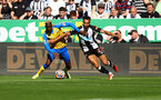 NEWCASTLE UPON TYNE, ENGLAND - AUGUST 28: Moussa Djenepo(L) of Southampton and Jacob Murphy of Newcastle during the Premier League match between Newcastle United  and  Southampton at St. James Park on August 28, 2021 in Newcastle upon Tyne, England. (Photo by Matt Watson/Southampton FC via Getty Images)