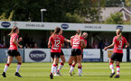 SOUTHAMPTON, ENGLAND - AUGUST 29: Southampton players congratulate Georgie Freeland of Southampton on opening the scoring during Women's National League Southern Premier match between Southampton Women and Gillingham at Snows Stadium on August 29, 2021 in Southampton, England. (Photo by Isabelle Field/Southampton FC via Getty Images)