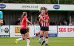 SOUTHAMPTON, ENGLAND - AUGUST 29: Ella Pusey(center) of Southampton celebrates scoring with team mates during Women's National League Southern Premier match between Southampton Women and Gillingham at Snows Stadium on August 29, 2021 in Southampton, England. (Photo by Isabelle Field/Southampton FC via Getty Images)