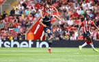 SOUTHAMPTON, ENGLAND - SEPTEMBER 11: Romain Perraud(L) of and Jarrod Bowen of West Ham during the Premier League match between Southampton  and  West Ham United at St Mary's Stadium on September 11, 2021 in Southampton, England. (Photo by Matt Watson/Southampton FC via Getty Images)