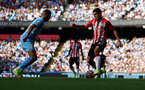 MANCHESTER, ENGLAND - SEPTEMBER 18: Mohamed Elyounoussi(R) of Southampton during the Premier League match between Manchester City and Southampton at Etihad Stadium on September 18, 2021 in Manchester, England. (Photo by Matt Watson/Southampton FC via Getty Images)