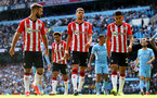 MANCHESTER, ENGLAND - SEPTEMBER 18: Adam Armstrong(L), Jan Bednarek and Mohamed Elyounoussi(R) of Southampton during the Premier League match between Manchester City and Southampton at Etihad Stadium on September 18, 2021 in Manchester, England. (Photo by Matt Watson/Southampton FC via Getty Images)
