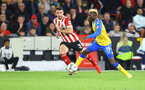 SHEFFIELD, ENGLAND - SEPTEMBER 21: Moussa Djenepo(R) of Southampton and Enda Stevens(L) of Sheffield United during the Carabao Cup Third Round match between Sheffield United and Southampton at Bramall Lane on September 21, 2021 in Sheffield, England. (Photo by Matt Watson/Southampton FC via Getty Images)