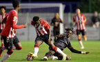SOUTHAMPTON, ENGLAND - SEPTEMBER 23: Kazeem Olaigbe(L) of Southampton during the Premier League Cup match between Southampton B Team and West Bromwich Albion at Snows Stadium on September 23, 2021 in Southampton, England. (Photo by Isabelle Field/Southampton FC via Getty Images)