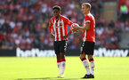 SOUTHAMPTON, ENGLAND - SEPTEMBER 26: Kyle Walker-Peters(L) and James Ward-Prowse of Southampton during the Premier League match between Southampton and Wolverhampton Wanderers at St Mary's Stadium on September 26, 2021 in Southampton, England. (Photo by Matt Watson/Southampton FC via Getty Images)