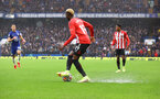LONDON, ENGLAND - OCTOBER 02: Moussa Djenepo of Southampton as the rain falls during the Premier League match between Chelsea and Southampton at Stamford Bridge on October 02, 2021 in London, England. (Photo by Matt Watson/Southampton FC via Getty Images)