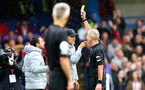LONDON, ENGLAND - OCTOBER 02: Chelsea manager Thomas Tuchel is shown a yellow card by referee Martin Atkinson during the Premier League match between Chelsea and Southampton at Stamford Bridge on October 02, 2021 in London, England. (Photo by Matt Watson/Southampton FC via Getty Images)