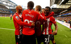 LONDON, ENGLAND - OCTOBER 02: Nathan Redmond(L) of Southampton congratulates James Ward-Prowse after scoring during the Premier League match between Chelsea and Southampton at Stamford Bridge on October 02, 2021 in London, England. (Photo by Matt Watson/Southampton FC via Getty Images)