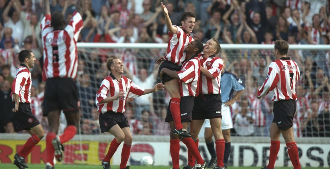 4 Oct 1997:  Jason Dodd of Southampton is congratulated by his team mates after scoring a goal during the FA Carling Premiership match  against West Ham United at The Dell in Southampton, England. Southampton won the match 3-0. \ Mandatory Credit: Ben Radford /Allsport